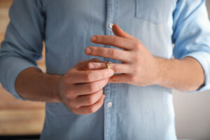 a man removing his wedding ring for a divorce