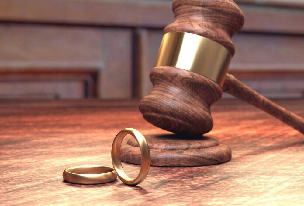 Gavel and wedding rings representing divorce process
